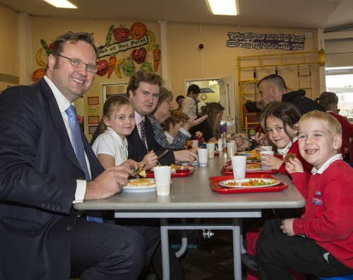 Schoolchildren enjoy their free school meal with Chester MP Stephen Mosley