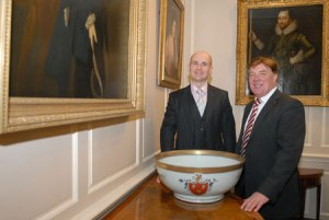Clive Pointon of the Tyrer Trust and Councillor Stuart Parker with the Cholmondeley Bowl. Photograph courtesy of Cheshire West and Chester Council.
