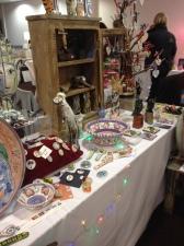 A ceramic stall full of little trinkets.