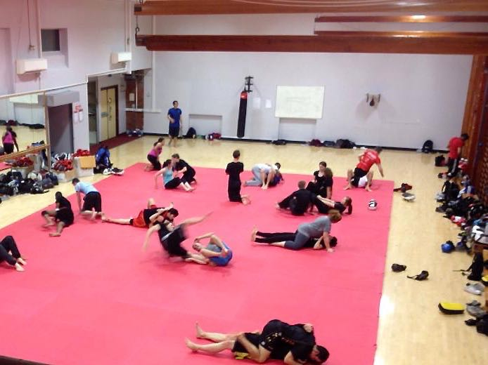 Students train the Brazilian Jiu Jitsu element of Mixed Martial Arts in the University's gymnasium
